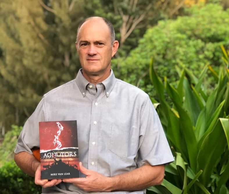 Mike Van Lear Holding His Book Agitators - C2